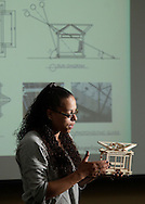 SUNY Orange student Angelique Barker holds a model of her design for a bus stop at the Middletown campus during a presentation at the Gilman Center in Middletown on Tuesday, April 13, 2010.