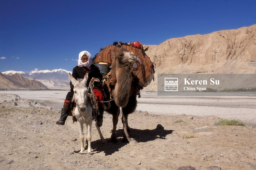 Kirghiz people traveling on Karakoram Highway with Mt Kunlun behind, Pamir Plateau, Xinjiang Province, Silk Road, China