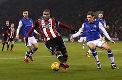 Leon Clarke of Sheffield United takes on Adam Reach of Sheffield Wednesday - Mandatory by-line: Robbie Stephenson/JMP - 12/01/2018 - FOOTBALL - Bramall Lane - Sheffield, England - Sheffield United v Sheffield Wednesday - Sky Bet Championship