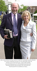 MR CHRIS WRIGHT former owner of QPR FC and MRS JANICE STINNES at a race meeting in Surrey on 27th April 2001.	ONH 30