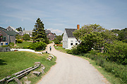 A person walks down Main Street on Monhegan Island.