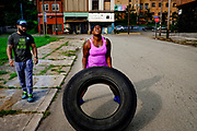 Former businesses decay in the background as personal trainer and nutritionist, George Luck, 38, offers encouragement to Michelle Martin, 30, as she works out in the streets of Braddock, Pa.<br /> <br />  Martin said she has lost over 100 pounds by eating healthy and exercising with Luck's program, which is one of the new business popping up in the blight-stricken town.<br /> <br /> With a population of just over 2,000 (down from a high of 20,879 at the height of the steel industry, Braddock is almost a ghost town even though it is the home of the last steel mill still in operation in the Monongahela River valley.