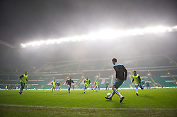 GLASGOW, SCOTLAND - Monday, November 7, 2011: Manchester City players warm-up in the fog ahead of the NextGen Series Group 1 match against Glasgow Celtic at Celtic Park. (Pic by David Rawcliffe/Propaganda)