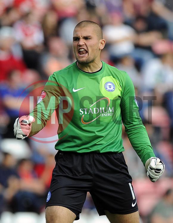 Peterborough United's Robert Olejnik celebrates  - Photo mandatory by-line: Joe Meredith/JMP - Tel: Mobile: 07966 386802 14/09/2013 - SPORT - FOOTBALL -  Ashton Gate - Bristol - Bristol City V Peterborough United - Sky Bet League One