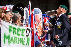 © Licensed to London News Pictures. 28/03/2017. London, UK. Campaigners and supporters of Sgt Blackman, known as Marine A, celebrate the high court ruling outside the Royal Courts of Justice in London on 28 March 2017. Sgt Blackman's murder charge is overturned to manslaughter and means he will be free in less than two weeks. Also known as Marine A, Sgt Blackman's was convicted of murder of a wounded Taliban fighter in Afghanistan in 2011. Photo credit: Tolga Akmen/LNP