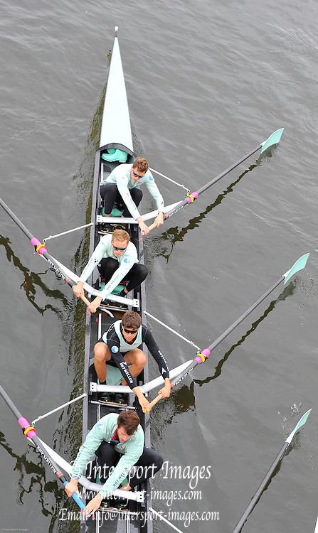 London, United Kingdom.  Friday Morning, Cambridge passing under Hammersmith Bridge.  2014, Varsity, Tideway Week, annual training week, both crews based at Putney, Championship Course,  River Thames;   04:52:44 - Friday  - 04/04/2014  [Mandatory Credit; Intersport Images].<br /> <br /> CUBC. Bow. Mike THORP, 2. Luke JUCKETT, 3. Ivo DAWKINS, 4. Steve DUDEK, 5. Helge GRUETJEN, 6. Matthew JACKSON, 7. Joshua HOOPER, Stroke, Henry HOFFSTOT and cox Ian MIDDLETON