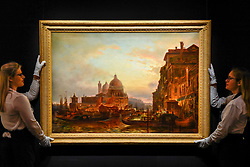 "© Licensed to London News Pictures. 22/11/2019. LONDON, UK. Technicians present ""Venice at Dusk"" by Alexei Bogoliubov (Est. GBP400-600k) at the preview for the upcoming sales of Russian artworks at Sotheby's New Bond Street.  The Russian Pictures and Works of Art, Fabergé and Icons sales take place on 26 November.  Photo credit: Stephen Chung/LNP"