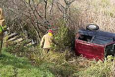 Tauranga-Car and trailer roll into ditch near Welcome Bay