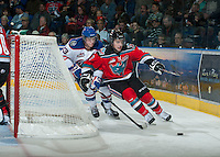 KELOWNA, CANADA - NOVEMBER 23:  Jesse Lees #2 of the Kelowna Rockets skates behind the net while being checked by Braden Christoffer #23 of the Regina Pats at the Kelowna Rockets on November 23, 2012 at Prospera Place in Kelowna, British Columbia, Canada (Photo by Marissa Baecker/Shoot the Breeze) *** Local Caption ***