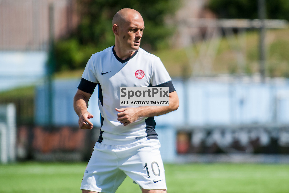 Hamilton Accies Player-manager Alex Neil warms up before the Hamilton Accies v Inverness Caledonian Thistle game in the Scottish Premiership at New Douglas Park in Hamilton, 9 August 2014. The game was Accies first game back in the top flight of Scottish Football. (c) Paul J Roberts / Sportpix.org.uk