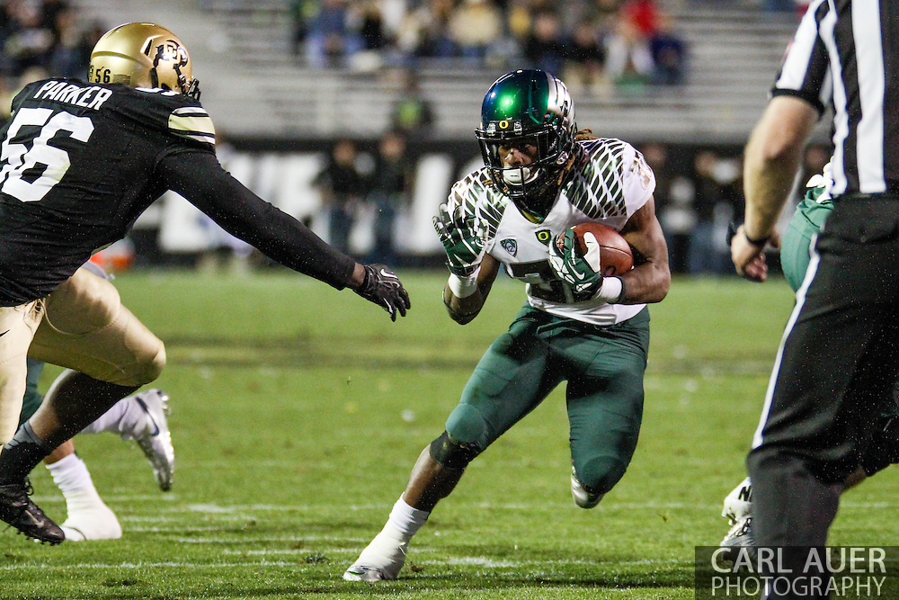 October 5th, 2013:  University of Oregon Ducks junior running back Ayele Forde (30) heads towards the end zone in fourth quarter action of the NCAA football game between the University of Oregon Ducks and the Colorado Buffaloes at Folsom Field in Boulder, Colorado