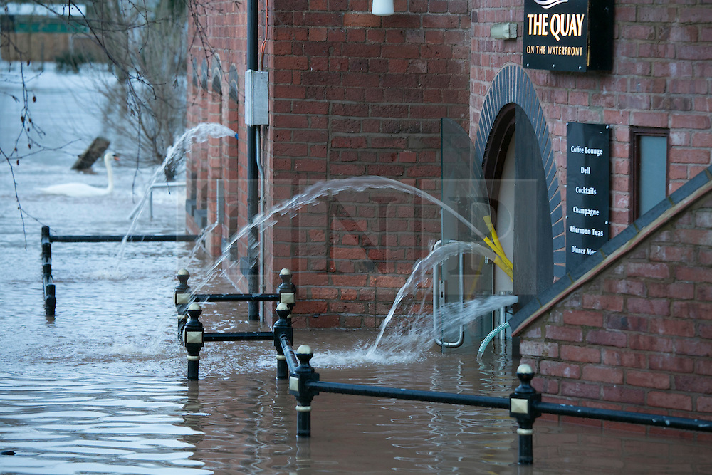 © Licensed to London News Pictures. 13/2/2014. Worcester, UK. The River Severn flowing through Worcester reaches an all time high. Pictured, pumping out at the Quay restaurant. Photo credit : Dave Warren/LNP