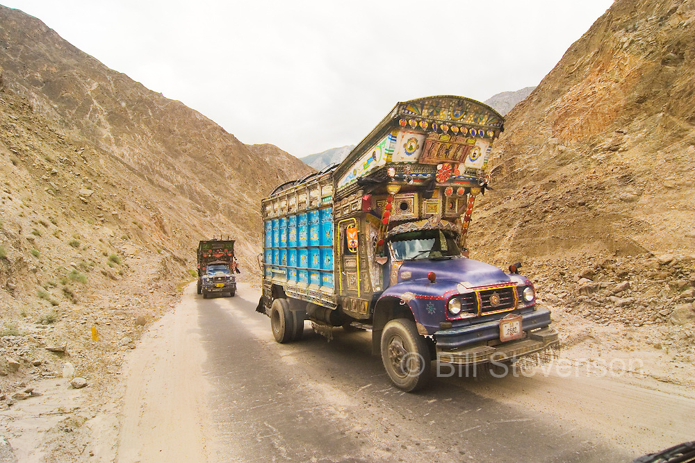 A photo of two trucks on the Skardu Road in Pakistan