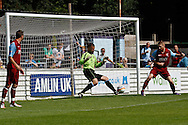 Picture by David Horn/Focus Images Ltd. 07545 970036.04/08/12.Harry Ricketts, Chesham United goalkeeper, fails to stop Arsenal increasing their lead during a friendly match at The Meadow, Chesham.