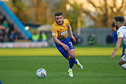 Alex MacDonald (7) runs forward during the EFL Sky Bet League 2 second leg Play Off match between Mansfield Town and Newport County at the One Call Stadium, Mansfield, England on 12 May 2019.