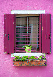 Window detail in colourful house in village of Burano near Venice in Italy