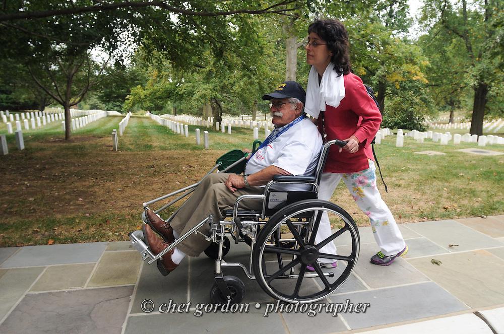 ARLINGTON, VA.  WWII Veterans and their escorts onboard the Hudson Valley Honor Flight at Arlington National Cemetery in Arlington, VA on Saturday, September 21, 2013.  © www.chetgordon.com