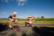Triathletes compete in the bike leg of the 5430 Triathlon in Boulder, Colorado.