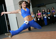 Keela Harris (L) performs a routine in the finals for prospective Denver Broncos cheerleaders in Denver, Colorado April 1, 2007.  Over 250 women applied for the 34 slots awarded. REUTERS/Rick Wilking (UNITED STATES)