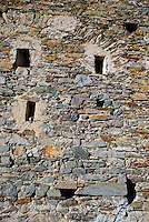 Ticino, Southern Switzerland. Detail of the wall of an old italian church showing the indentations of small windows.