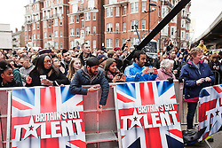 © Licensed to London News Pictures. 11/02/2014. London, UK. Fans gather are waiting the judges during Britain's Got Talent 2014 auditions outside the Hammersmith Apollo. Photo credit : Andrea Baldo/LNP