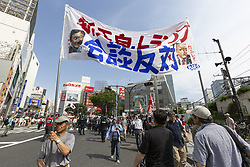 May 26, 2019 - Tokyo, Japan - Protesters holding placards against the US President Donald Trump's visit to Japan during a rally in Shinjuku. Tokyo Police prevented a clash between a small group of right-wing people and protesters against US President Donald Trump's visit to Japan and the country's new Emperor Naruhito. Trump is currently on an official four-day state visit to Japan. He is the first foreign leader to visit the country after the coronation of Emperor Naruhito. (Credit Image: © Rodrigo Reyes Marin/ZUMA Wire)