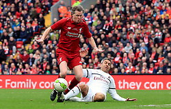 Liverpool's Steve McManaman (left) and Milan's Alessandro Costacurta battle for the ball during the Legends match at Anfield Stadium, Liverpool.