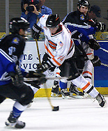 - Council Bluffs, IA. 4/29/2003 River City Lancers defender Jason Dest tries to clear the puck from deep in their own territory at the Mid America Center Tuesday evening (Chris Machian/Prairie Pixel Group)