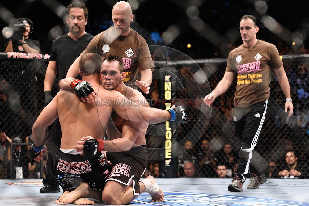 "ATLANTA, GEORGIA, SEPTEMBER 6, 2008: Rick Franklin (kneeling) embraces Matt Hamill after their fight at ""UFC 88: Breakthrough"" inside Philips Arena in Atlanta, Georgia on September 6, 2008"