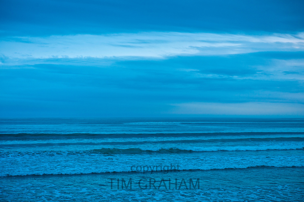 The surf at high tide at the beach resort of Lahinch (Lehinch) at twilight, County Clare, West Coast of Ireland