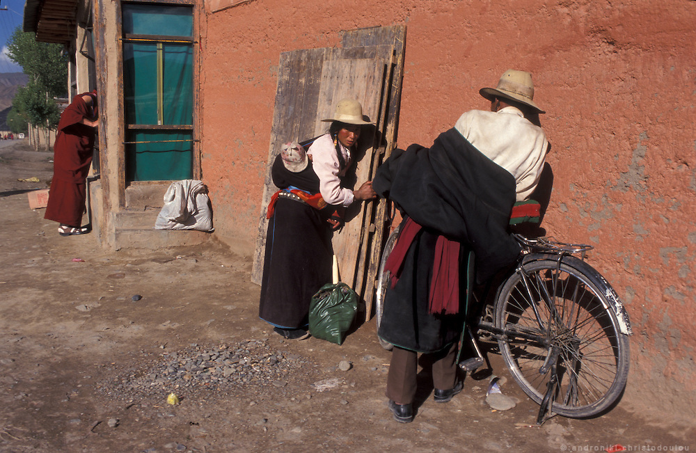 Pilgrims in front of a monk's home..LAMBRANG MONASTERY IN XIAHE - CHINA.copyright: Androniki Christodoulou.