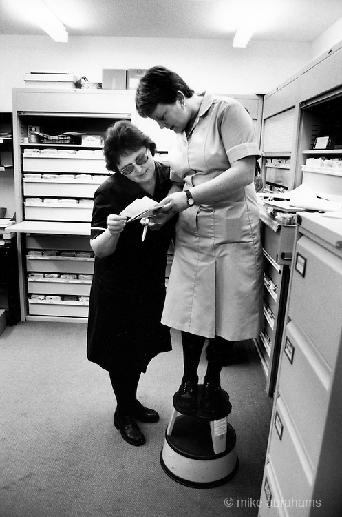 Practice nursees in the record department at at local health centre. Liverpool, 1999. England, United Kingdom