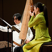 "February 18, 2012 - New York, NY : .From left, Fuyuhiko Sasaki plays the kugo (angular harp) and Mayumi Miyata plays the sho (mouth organ) as they perform the World Premiere of Akiko Yamane's 'Dots Collection No. 13' (2012) during ""Resonances of the Kugo,"" part of the 2012 New York Music From Japan Festival, at Merkin Concert Hall on Saturday. .CREDIT: Karsten Moran for The New York Times"