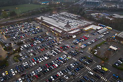 © Licensed to London News Pictures. 19/03/2020. London, UK. The car park of a Tesco Extra store in New Malden, south London is full at 06:15am as shoppers arrive. Tesco is closing 24 hour stores overnight to re-stock for opening at 6am. The government has announced that all schools will close from Friday as the virus takes hold. Photo credit: Peter Macdiarmid/LNP