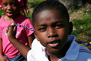 February 28th 2006. New Orleans, Louisiana. United States..Kids wait for the Zulu Mardi Gras walking Parade on Orleans Avenue.