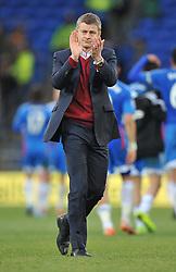 Cardiff City Manager, Ole Gunnar Solskjær claps the home fans. - Photo mandatory by-line: Alex James/JMP - Tel: Mobile: 07966 386802 22/02/2014 - SPORT - FOOTBALL - Cardiff - Cardiff City Stadium - Cardiff City v Hull City - Barclays Premier League