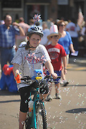 Marian Roberts rides a bike in the 4th of July parade in Oxford, Miss. on Monday, July 4, 2011.