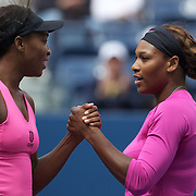 Serena Williams (right) and Venus Williams, USA, in action against Alisa Kleybanova, and Ekaterina Makarova, Russia, in the Women's doubles competition during the US Open Tennis Tournament at Flushing Meadows, New York, USA, on Thursday, September 10, 2009. Photo Tim Clayton