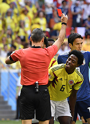 June 19, 2018 - Saransk, Russia - The referee gives a red card to CARLOS SANCHEZ (R bottom) of Colombia during a Group H match between Colombia and Japan at the 2018 FIFA World Cup in Saransk, Russia. (Credit Image: © He Canling/Xinhua via ZUMA Wire)