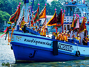 "02 JUNE 2017 - SAMUT SAKHON, THAILAND: Boats carrying the devotees of the City Pillar Shrine sail on the Tha Chin River in Samut Sakhon during the procession for the shrine. The Chaopho Lak Mueang Procession (City Pillar Shrine Procession) is a religious festival that takes place in June in front of city hall in Samut Sakhon. The ""Chaopho Lak Mueang"" is  placed on a fishing boat and taken across the Tha Chin River from Talat Maha Chai to Tha Chalom in the area of Wat Suwannaram and then paraded through the community before returning to the temple in Samut Sakhon. Samut Sakhon is always known by its historic name of Mahachai.      PHOTO BY JACK KURTZ"