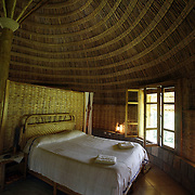 The secluded riverfront Aregash Lodge, whose 10.round, thatched-roof tukuls (bungalows) are decorated with woven.baskets and handcrafts typical of the local Sidama people.