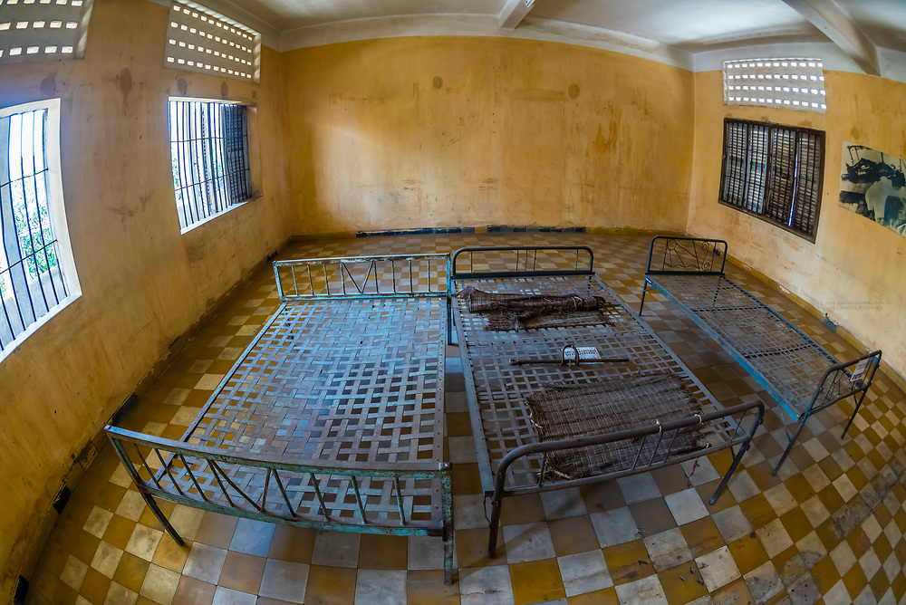 Prisoners beds, Tuol Seng Genocide Museum; originally a school, it was turned into the Khmer Rouge Torture headquarters. Men, women and children were tortured and killed before being moved under darkness to be buried in mass graves at the Killing Fileds of Choeung Ek (outside the city); Phnom Penh, Cambodia.