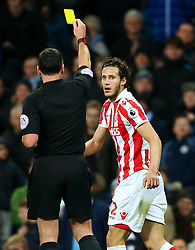Ramadan Sobhi of Stoke City receives a yellow card  - Mandatory by-line: Matt McNulty/JMP - 08/03/2017 - FOOTBALL - Etihad Stadium - Manchester, England - Manchester City v Stoke City - Premier League