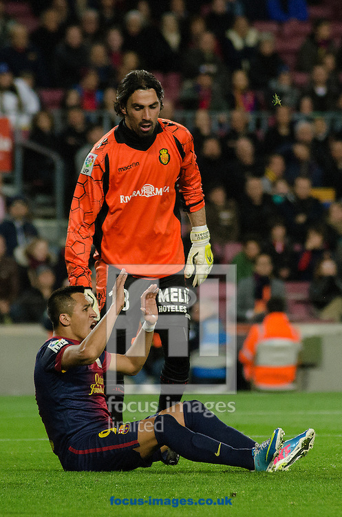 Picture by Cristian Trujillo/Focus Images Ltd +34 64958 5571.06/04/2013.Alexis Sánchez of FC Barcelona and Dudú Aouate of Real Club Deportivo Mallorca during the La Liga match at Camp Nou, Barcelona.