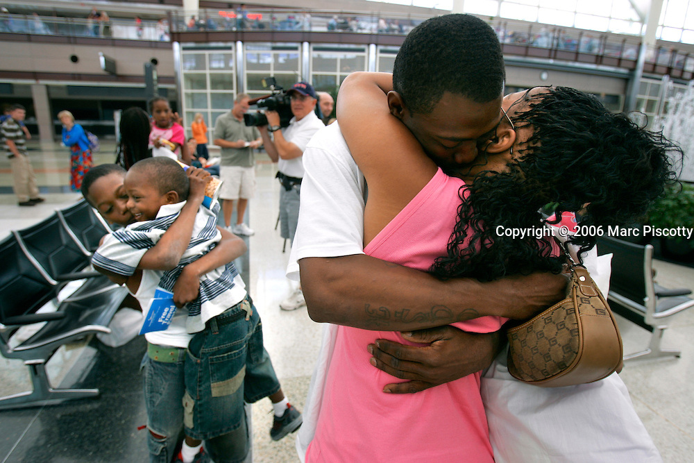 "Hurricane Katrina evacuee Cash Smith, 24, of New Orleans and his two kids Betty Ann Matthews, 7, and Tahj Sweeting, 4, were reunited with other family members Monday September 5, 2005 at DIA through the efforts of Rocky Mountain Relief, a grass-roots effort that is helping people to relocate to Denver in the wake of the disaster. The family members were separated while trying to leave the Superdome after the flooding overtook the city and Smith said he likes what he's seen so far of Denver and the generosity of strangers here. He said, ""we'll start over from scratch here in Denver"". Frontier Airlines, Sage Hospitality and Doubletree hotels have all donated flights, lodging and meals in the effort. Cash Smith (right) embraces his common-law wife Latoya Matthews (far right) as Tahj Sweeting (left center, in striped shirt) and Sam Smith (far left) hug in the background. Sam Smith is Cash's little brother..(MARC PISCOTTY / © 2005)"