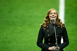 SWANSEA, WALES - Tuesday, March 26, 2013: Welsh singer Sophie Evans sings the national anthem before the 2014 FIFA World Cup Brazil Qualifying Group A match against Croatia at the Liberty Stadium. (Pic by Tom Hevezi/Propaganda)