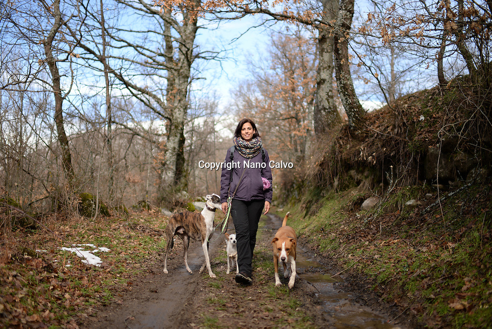 Young woman walking in nature with dogs