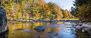 The peak intensity of autumn foliage color is around the first week of October along the Swift River, beside Kancamagus Highway (NH Route 112) in White Mountain National Forest, New Hampshire, USA. The White Mountains (a range in the northern Appalachian Mountains) cover a quarter of the state of New Hampshire. The panorama was stitched from 3 overlapping photos.