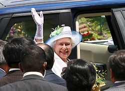epa00670711 Queen Elizabeth II (C) of the United Kingdom waves goodbye to the crowd before departing from the Singapore Turf Club on Saturday 18 March 2006. The Queen concludes her three-day visit to the city state on Saturday.  EPA/HOW HWEE YOUNG