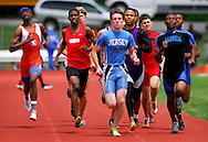 8 MAY 2010 -- COLLINSVILLE, Ill. -- Runners, including Jerey's Ryan Todd (light blue) Collinsville's Dominique Manley (purple and black and Cahokia's Ly'Derrick Ward (blue and black CQ) compete in the 800-meter run at the Collinsville Invitational at Collinsville High School Saturday, May 8, 2010. Photo © copyright 2010 by Sid Hastings.
